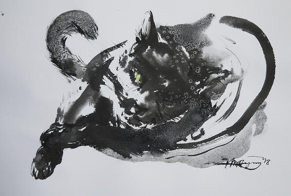 眠気を誘う黒猫。